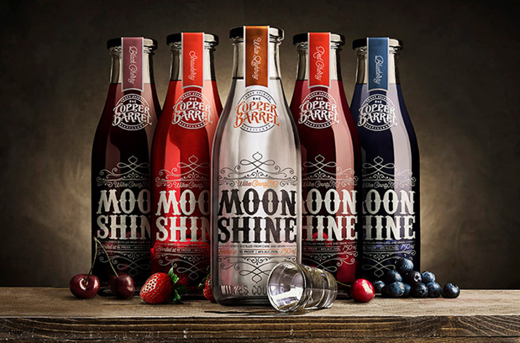 Photo of Copper Barrel's original series of five different moonshine flavors.